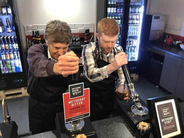 Wetherby Brew Co brewing experience guests pulling a pint