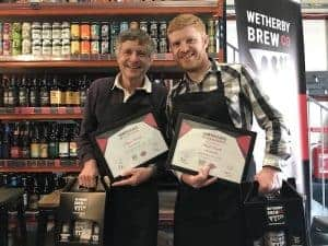Wetherby Brew Co brewing experience guests holding a certificate