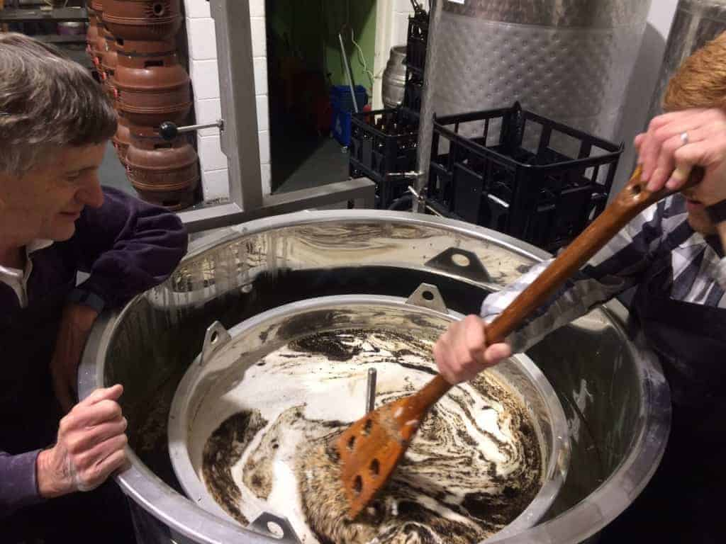 Wetherby Brew Co brewing experience guests stirring mash paddle